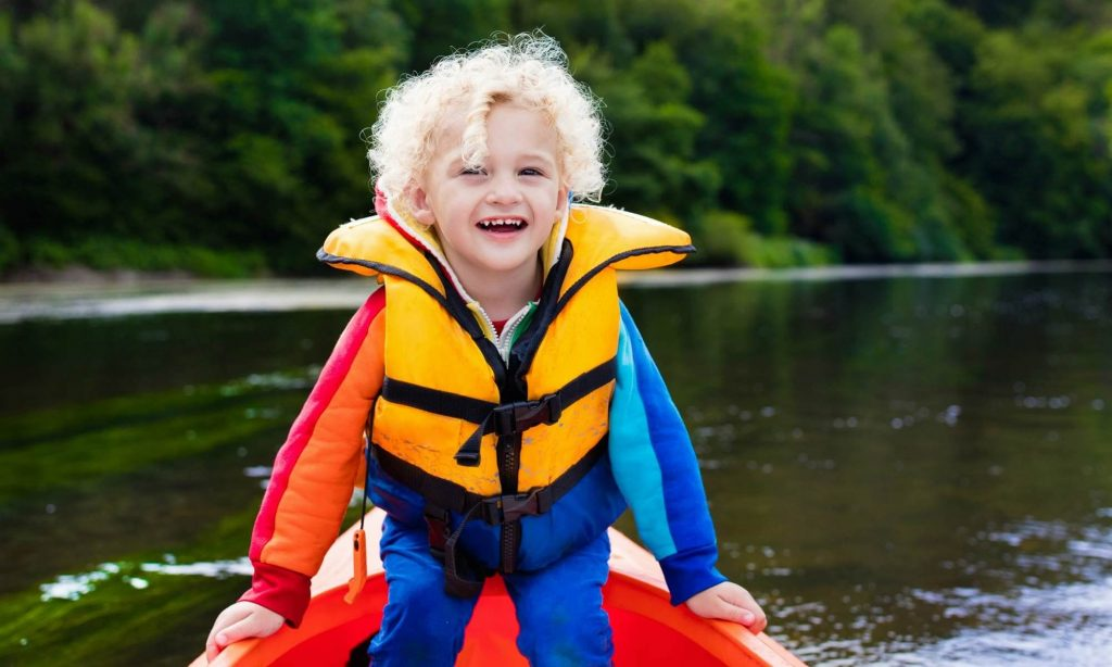 a toddler wearing a life vest